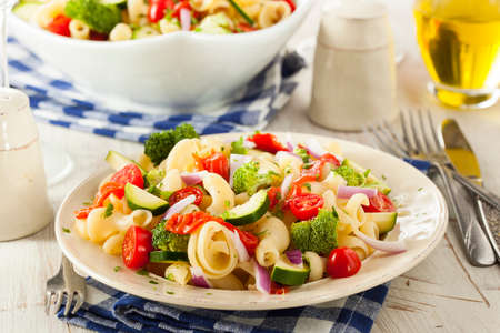 Healthy Homemade Pasta Salad with Tomatoes Onions and Broccoli photo