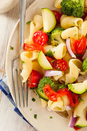 broccoli salad: Healthy Homemade Pasta Salad with Tomatoes Onions and Broccoli Stock Photo
