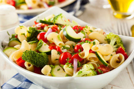 pasta salad: Healthy Homemade Pasta Salad with Tomatoes Onions and Broccoli Stock Photo