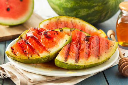 watermelon slice: Ripe Healthy Organic Grilled Watermelon with Honey Stock Photo