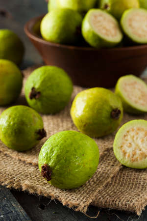 guava: Fresh Organic Green Guava on a Background