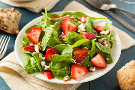 fresh spinach: Organic Healthy Strawberry Balsamic Salad with Spinach Stock Photo