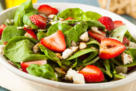 Organic Healthy Strawberry Balsamic Salad with Spinach Stock Photo