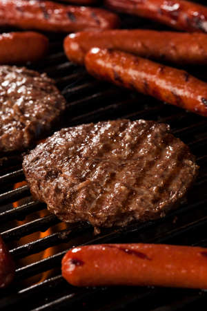 charbroiled: Delicious Hamburgers and Hot Dogs on the Grill Stock Photo