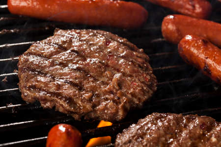 Delicious Hamburgers and Hot Dogs on the Grill photo