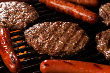 Delicious Hamburgers and Hot Dogs on the Grill Stock Photo
