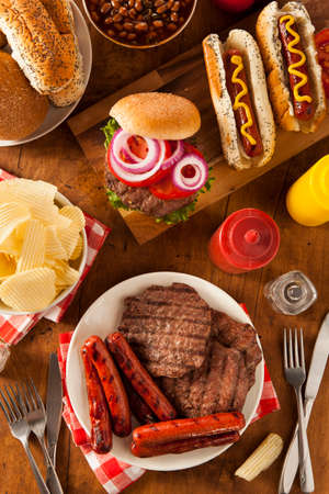 hotdog sandwiches: Grilled Hamburgers and Hot Dogs Ready to Eat Stock Photo