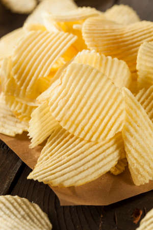 crinkle: Unhealthy Crinkle Cut Potato Chips Ready to Eat Stock Photo