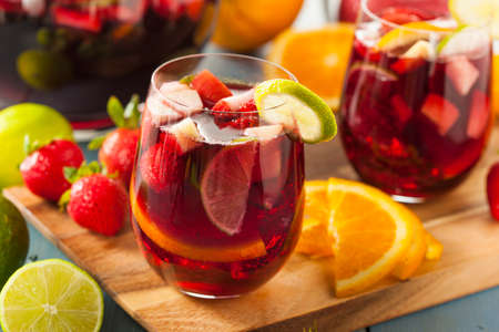 Homemade Delicious Red Sangria with Limes Oranges and Apples photo