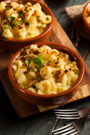macaroni and cheese: Baked Homemade Macaroni and Cheese with Parsley Stock Photo