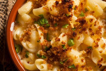 Baked Homemade Macaroni and Cheese with Parsley Stock Photo