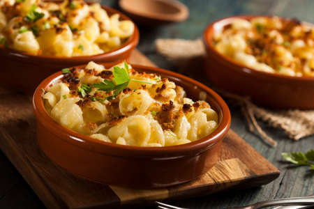 macaroni: Baked Homemade Macaroni and Cheese with Parsley Stock Photo