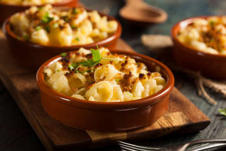 cheddar cheese: Baked Homemade Macaroni and Cheese with Parsley Stock Photo