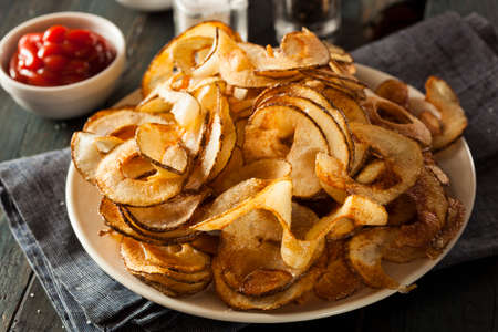 espiral: Homemade Potato Chips corte del espiral de la Feria Foto de archivo