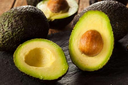 avocados: Organic Raw Green Avocados Sliced in Half