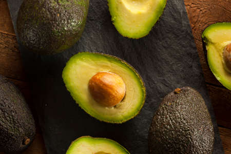 Organic Raw Green Avocados Sliced in Half Stock Photo - 30004638