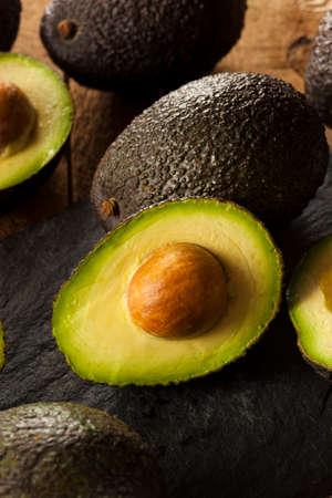 Organic Raw Green Avocados Sliced in Half photo