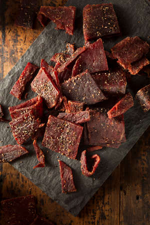 Dried Peppered Beef Jerky Cut in Strips Stock Photo