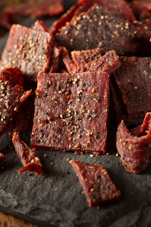 peppered: Dried Peppered Beef Jerky Cut in Strips Stock Photo