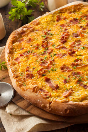Homemade Breakfast Pizza with Bacon Eggs and Potatoes