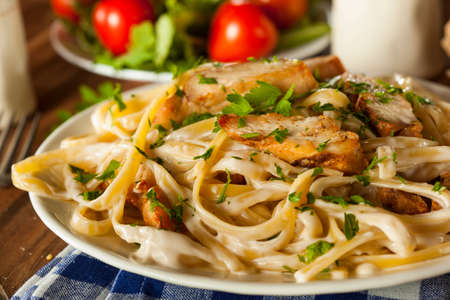 creamy: Homemade Fettucini Aflredo Pasta with Chicken and Parsley