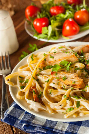 chicken noodle: Homemade Fettucini Aflredo Pasta with Chicken and Parsley