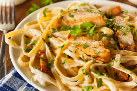 Homemade Fettucini Aflredo Pasta with Chicken and Parsley photo