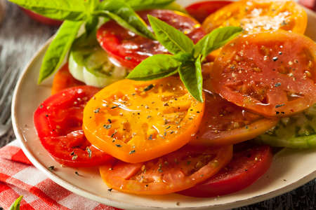 food dressing: Healthy Heirloom Tomato Salad with Basil and Dressing