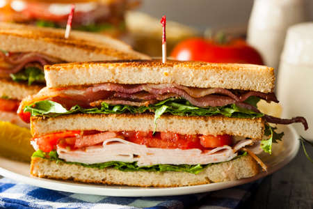 turkey bacon: Turkey and Bacon Club Sandwich with Lettuce and Tomato Stock Photo
