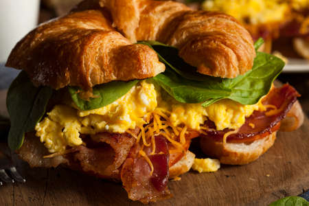 Ham and Cheese Egg Breakfast Sandwich on a Croissant photo