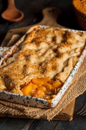 cobbler: Homemade Flakey Peach Cobbler in a Dish Stock Photo
