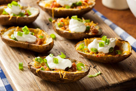 Homemade Potato Skins with Bacon Cheese and Sour Cream Stock Photo