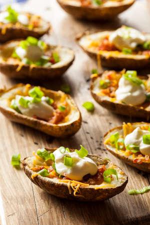 Homemade Potato Skins with Bacon Cheese and Sour Cream Banco de Imagens