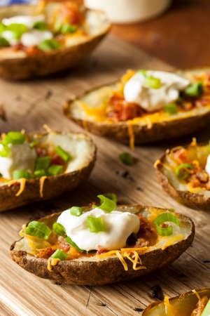 Homemade Potato Skins with Bacon Cheese and Sour Cream photo