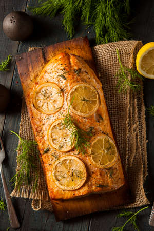 pink salmon: Homemade Grilled Salmon on a Cedar Plank with Dill Stock Photo