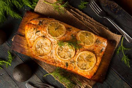 cedar: Homemade Grilled Salmon on a Cedar Plank with Dill Stock Photo