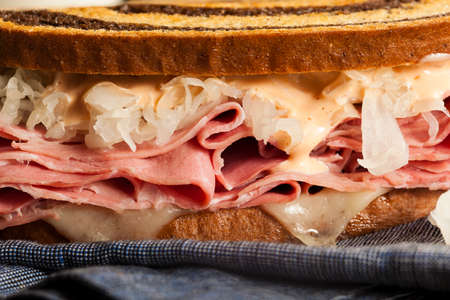 reuben: Homemade Reuben Sandwich with Corned Beef and Sauerkraut Stock Photo