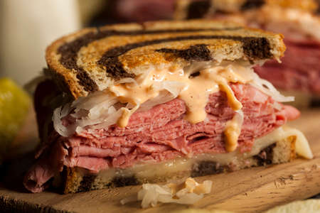 Homemade Reuben Sandwich with Corned Beef and Sauerkraut Фото со стока