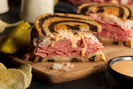 reuben: Homemade Reuben Sandwich with Corned Beef and Sauerkraut Stock Photo