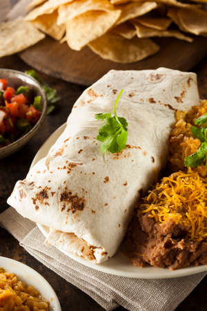 Homemade Giant Beef Burrito with Lettuce Salsa and Rice photo