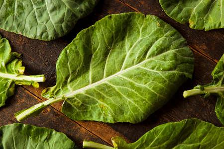 Raw Organic Green Collard Greens on a Background