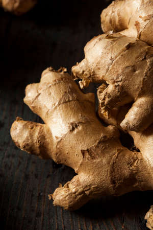 ginger health: Raw Organic Ginger Root on a Background Stock Photo