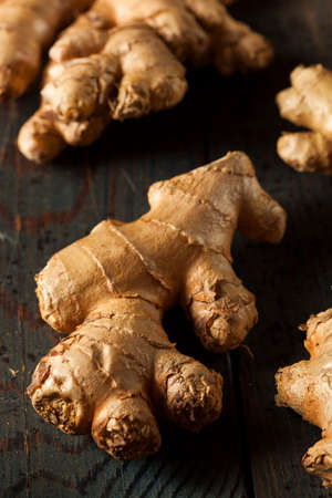 Raw Organic Ginger Root on a Background Imagens