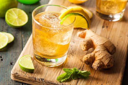 ale: Organic Ginger Ale Soda in a Glass with Lemon and Lime