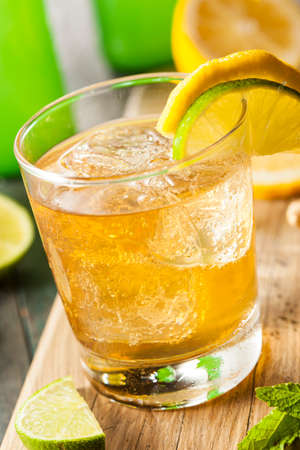 fresh ginger: Organic Ginger Ale Soda in a Glass with Lemon and Lime