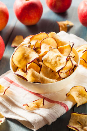 dried food: Baked Dehydrated Apples Chips in a Bowl