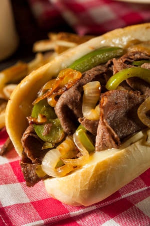 Homemade Philly Cheesesteak Sandwich with Onions and Peppers photo