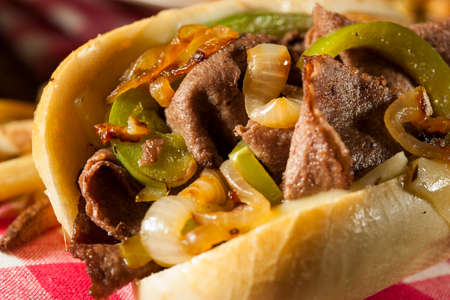 steak sandwich: Homemade Philly Cheesesteak Sandwich with Onions and Peppers Stock Photo
