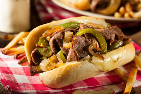 Homemade Philly Cheesesteak Sandwich with Onions and Peppers Фото со стока