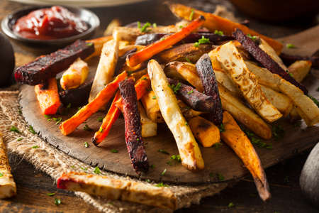 carrot: Oven Baked Vegetable Fries with Carrots, Potato, and Beets Stock Photo